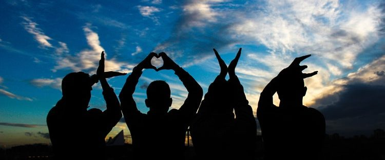 sober community group in Boston Massachusetts with love hand gestures