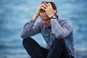 Man Thinking About Alternatives for Alcohol and Drugs While Stressed