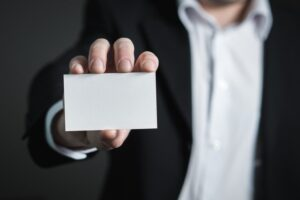 Man holding blank card, not identifying with his addiction.